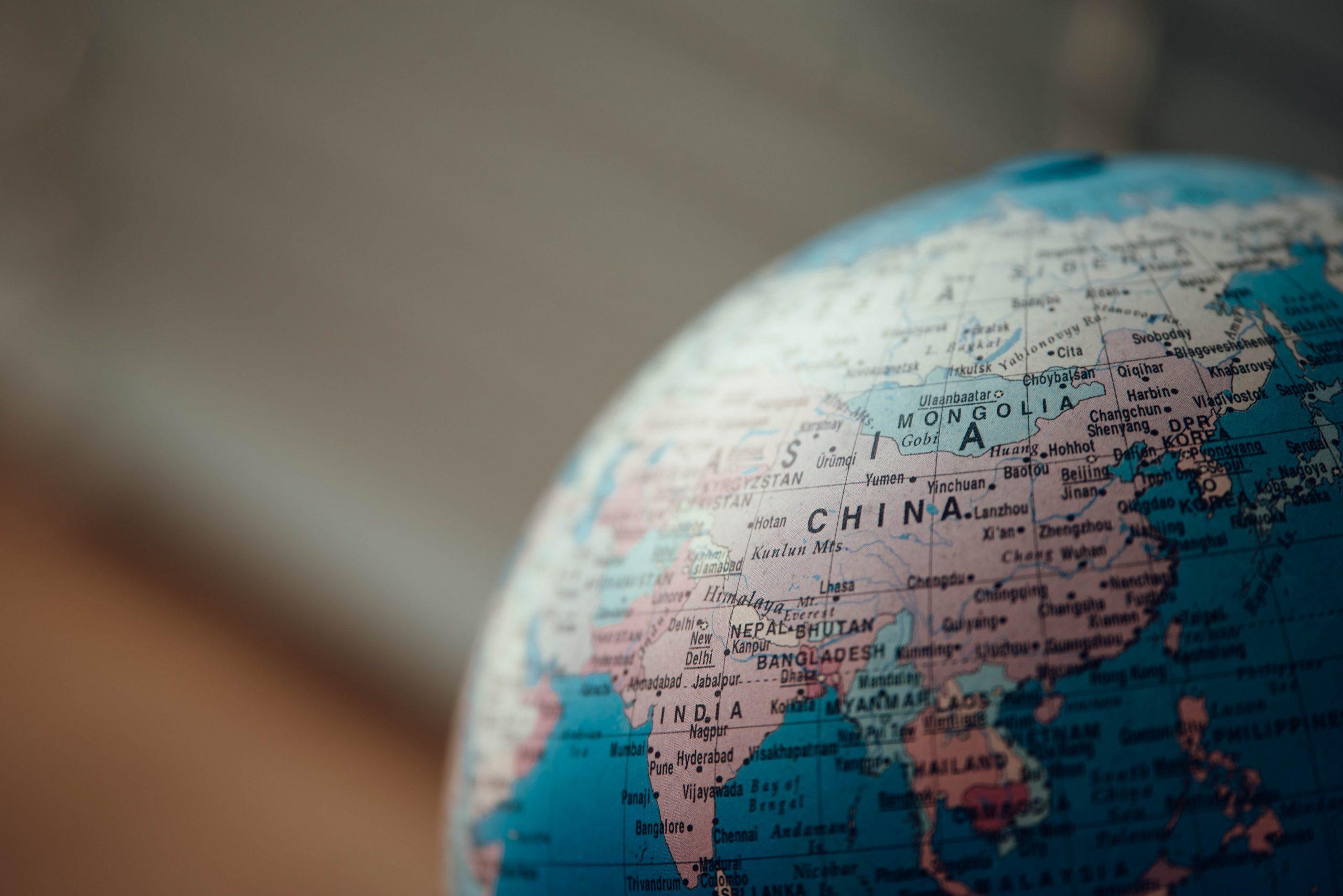 close up photo of blue desk globe