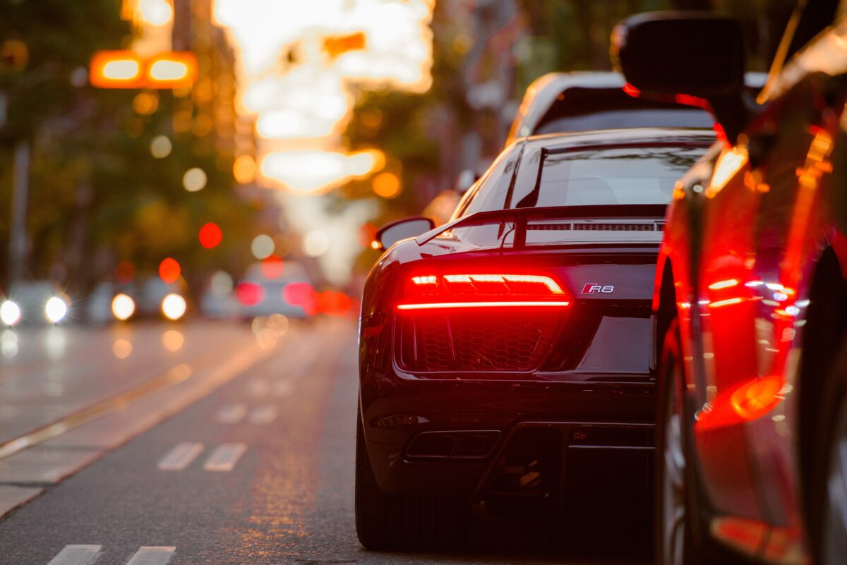 black Audi R8 parked beside road