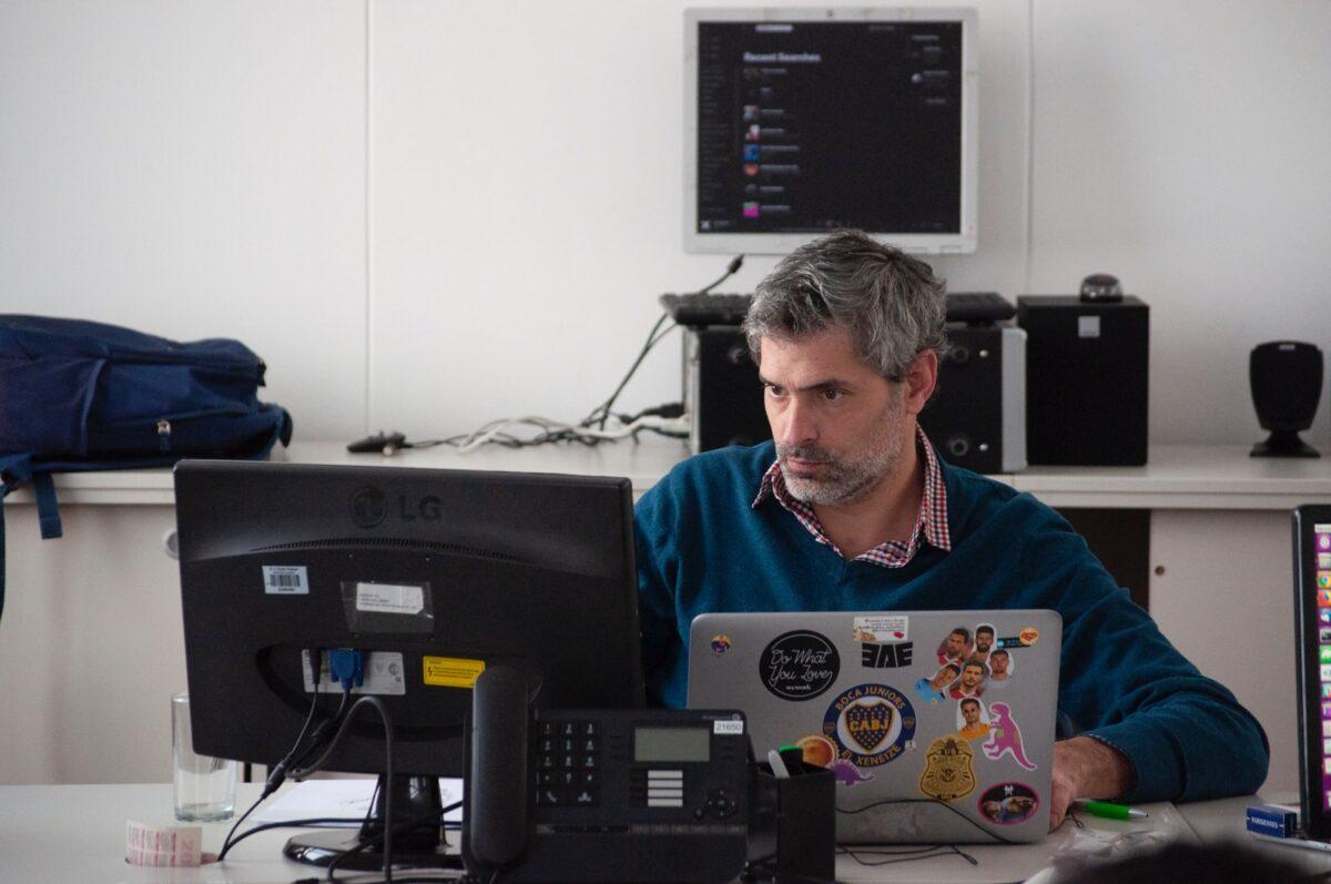 man sitting beside desk